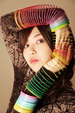 Cute Asian girl. Playing with slinkies stock photo