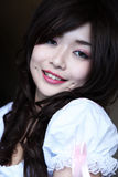 Cute Asian girl. Smiling sweetly royalty free stock photos