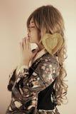 Cute Asian girl. Praying for love royalty free stock photos