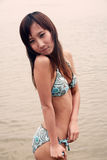 Cute Asian girl in a bikini Royalty Free Stock Photography