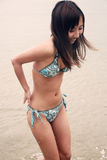 Cute Asian girl in a bikini Royalty Free Stock Image
