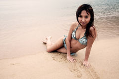 Cute Asian girl in a bikini Royalty Free Stock Photo