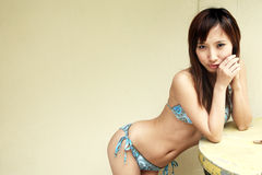 Cute Asian girl in a bikini Stock Images