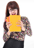 Cute asian girl biting colorful books Royalty Free Stock Image