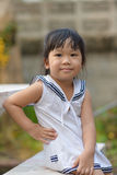 Cute Asian girl. Asian cute child sitting on a chair Stock Photos