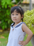 Cute Asian girl. Asian cute child standing akimbo Stock Image