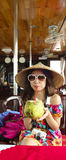 Cute Asian girl drinking coconut juice. Asian girl drinking coconut juice with a straw. she is wear a chinese hat Stock Image