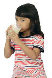 Cute Asian Girl Drinking Milk Royalty Free Stock Images