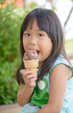 Cute asian girl eat ice cream Stock Photography