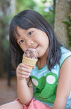 Cute asian girl eat ice cream Royalty Free Stock Photo