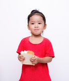 Cute asian girl eating slide bread Royalty Free Stock Photo