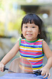 Cute asian girl  enjoy playing toy car. At home Royalty Free Stock Image