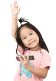 Cute asian girl enjoy to play mobile phone isolated Stock Photo
