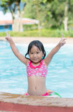 Cute Asian girl enjoy to swimming Royalty Free Stock Photos