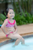 Cute Asian girl enjoy to swimming Stock Image