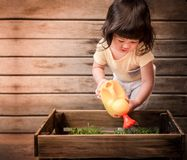 Cute Asian Girl Enjoying with Gardening Activities, A 2 Years Ol Royalty Free Stock Photos