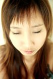 Cute Asian girl with eyes closed Royalty Free Stock Photography