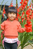 Cute Asian girl and flower. Cute Asian girl in the flower garden Stock Photography