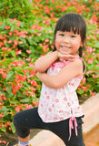 Cute Asian girl and flower. Cute asian girl  smile in the garden Stock Image