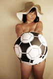 Cute Asian girl with football Royalty Free Stock Photos