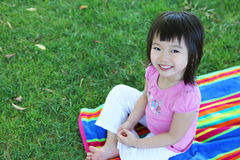 Cute Asian Girl on Grass Royalty Free Stock Images