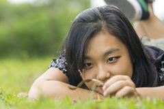 Cute asian girl laying on the grass Stock Photography