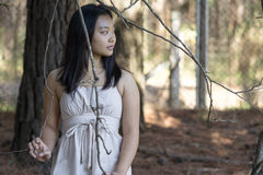 Cute asian girl on blurred woods background Royalty Free Stock Photography
