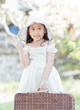 Cute asian girl hold wicker bag Stock Photography