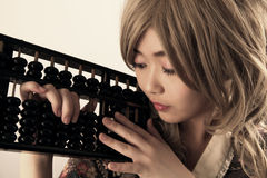 Cute Asian girl. Holding an abacus royalty free stock images