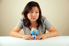 Cute Asian girl holding a globe Royalty Free Stock Images
