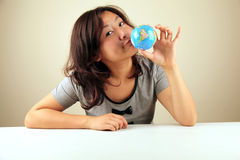 Cute Asian girl holding a globe Stock Image