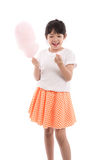Cute asian girl holding pink cotton candy Stock Photos