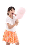 Cute asian girl holding pink cotton candy Royalty Free Stock Photos