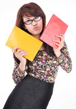 Cute asian girl holding two books, red and yellow colors Royalty Free Stock Photo