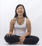 Cute asian girl on isolated background laughing on meditation Stock Photography