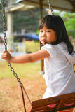 Cute Asian girl jogging at the playground. Stock Image