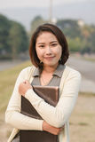 Cute asian girl with laptop Stock Photo