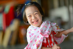 Cute Asian girl laughing. Royalty Free Stock Images