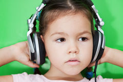 Cute asian girl listening to music Stock Images