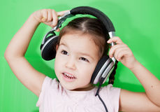 Cute asian girl listening to music Royalty Free Stock Photography