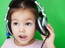 Cute asian girl listening to music Stock Photography