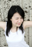 Cute Asian girl looking aat viewer Royalty Free Stock Photography