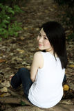 Cute Asian girl looking away stock images