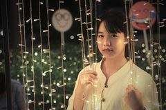 A cute Asian girl looking at the led. lighting stock photos