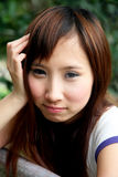 Cute Asian girl looking at viewer Stock Image