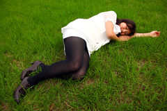 Cute Asian girl lying down Royalty Free Stock Photography