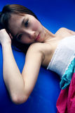 Cute Asian girl lying down Royalty Free Stock Images