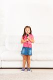 Cute Asian girl with microphone stock images