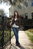 Cute asian girl outside large home Royalty Free Stock Photography
