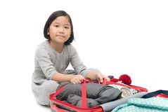 Cute asian girl packing suitcases preparing for travel trip isol. Ated on white background Royalty Free Stock Images